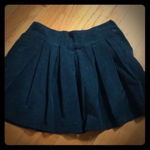 Navy pleated mini skirt with hidden pockets
